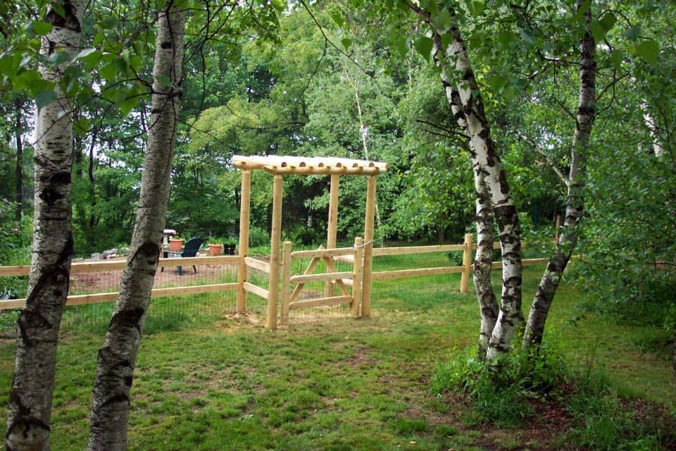 2 rail cedar post and rail fence with wire mesh for animal enclosure ...